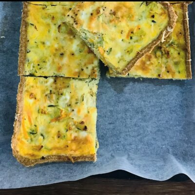 2 Leek, Carrot, Courgette Tart Slices With Parmesan Cheese.