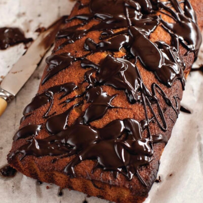 Banana Bread Traybake Square With Dark Chocolate Drizzle