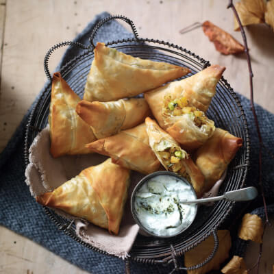 3 Vegetable Samosas Served With Yoghurt And Mint Dip