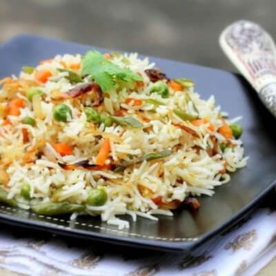 Aromatic Royal Basmati Rice Cooked With Whole Spices And Baby Vegetables. Vegan