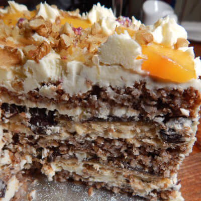 Luxurious Layered Walnut, Peach And Jaffa's Cake Slice
