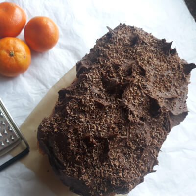 Succulent Jaffa-Orange Drizzle Cake With Rich Chocolate Buttercream And Chocolate Curl Topping