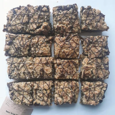 Triple-Layer Wholegrain Oat Crumble With Fudgy Date Caramel And Dark Chocolate Drizzle